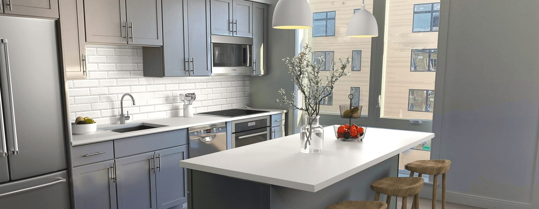 rendering of spacious kitchen that includes an island, ample counter-space and plenty of natural lighting through large windows